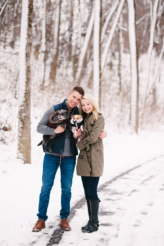 young couple with dogs in snow