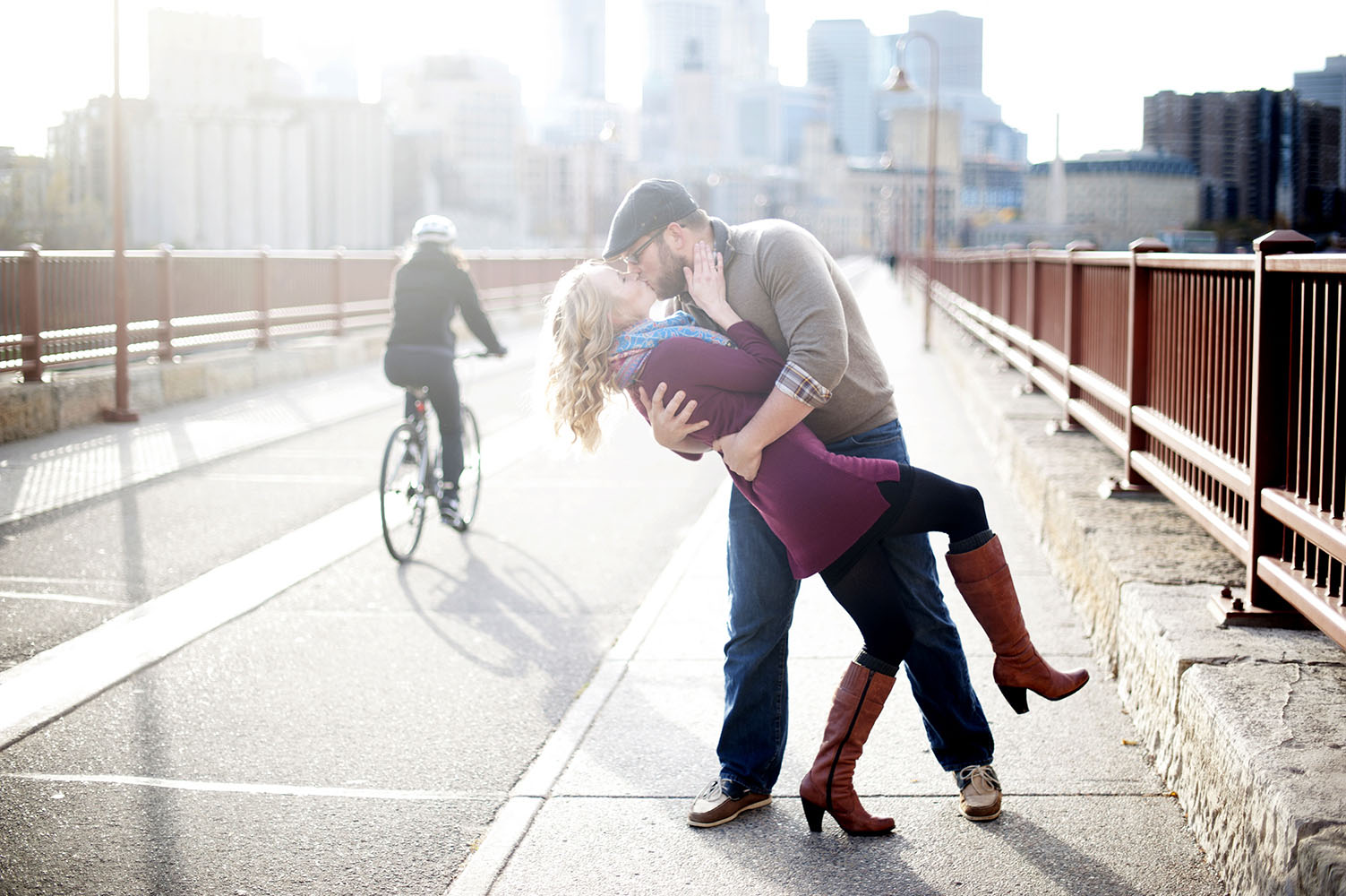 couple dip kissing on the stone arch bridge