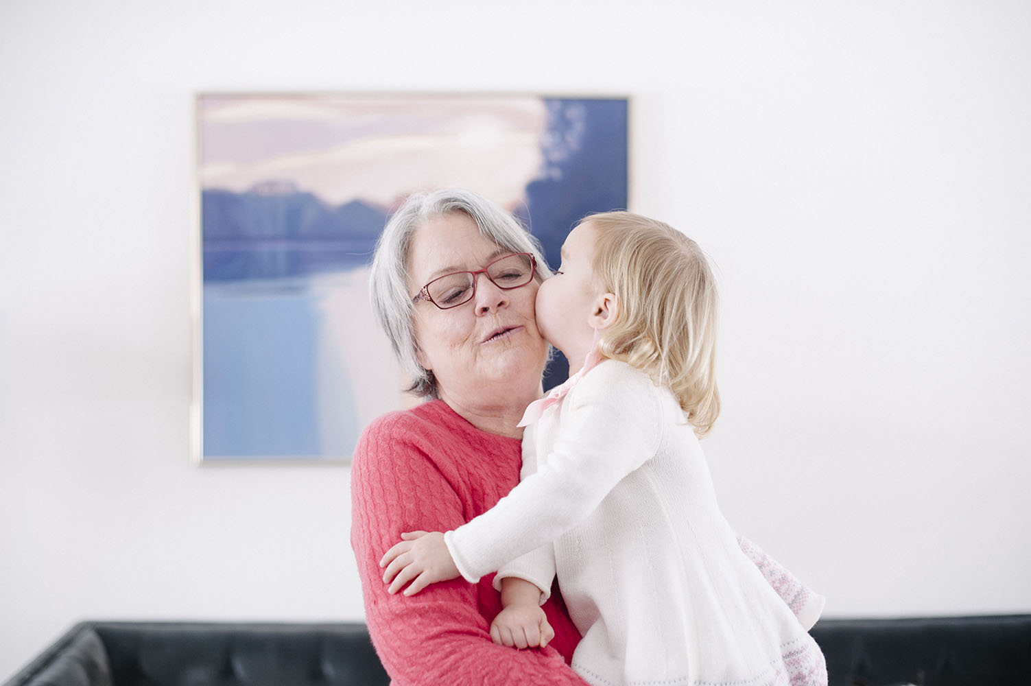 Girl kissing grandma