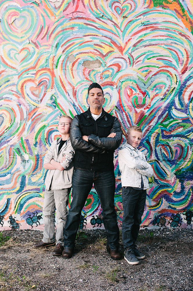 Family in front of rainbow heart mural