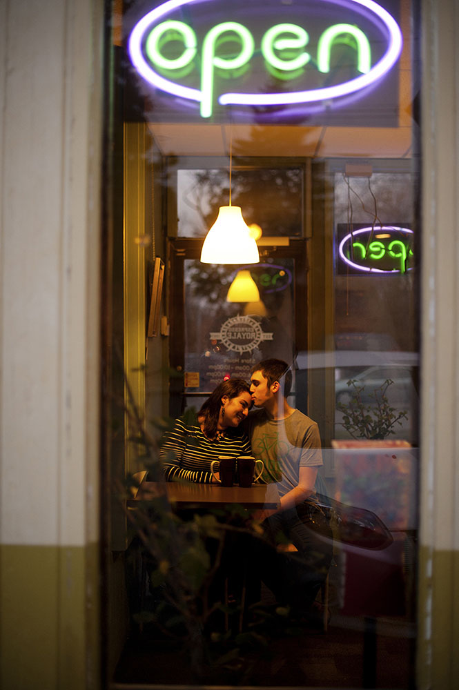 an engaged couple in a cafe