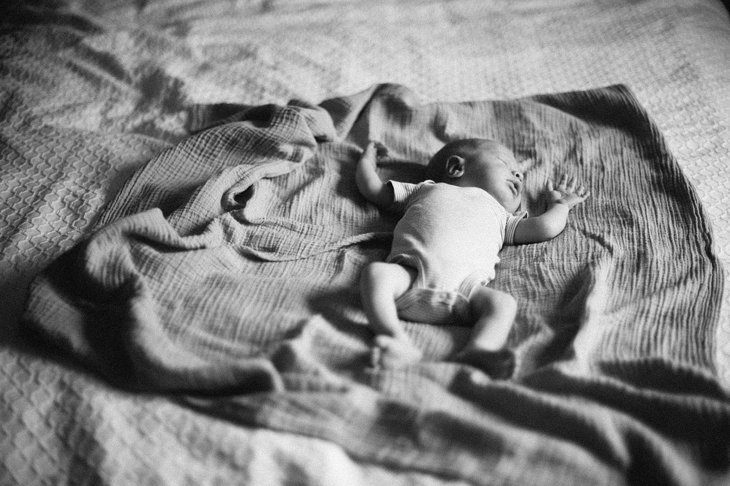 Newborn baby on bed