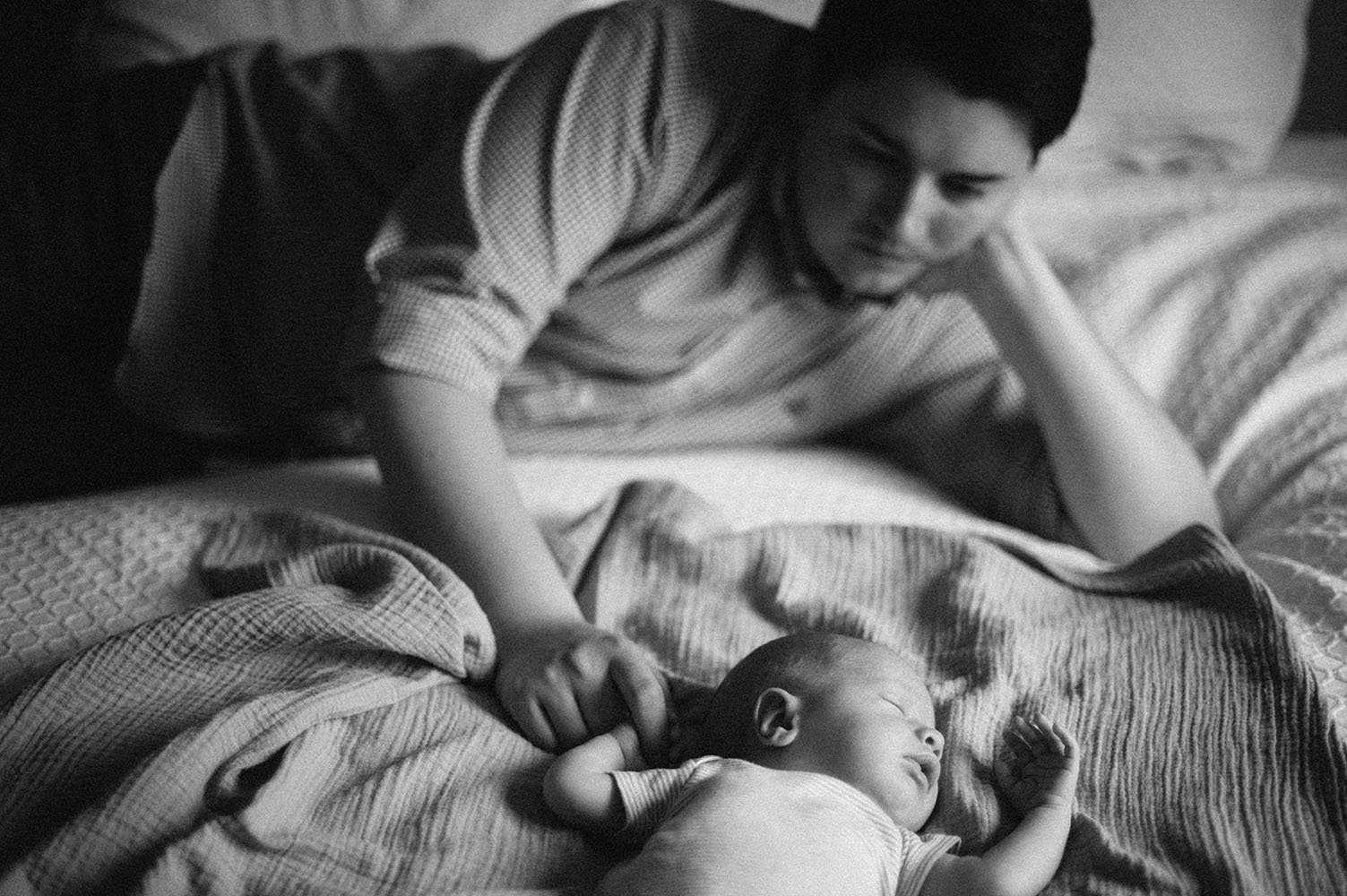 Black and white photo of Dad and newborn baby