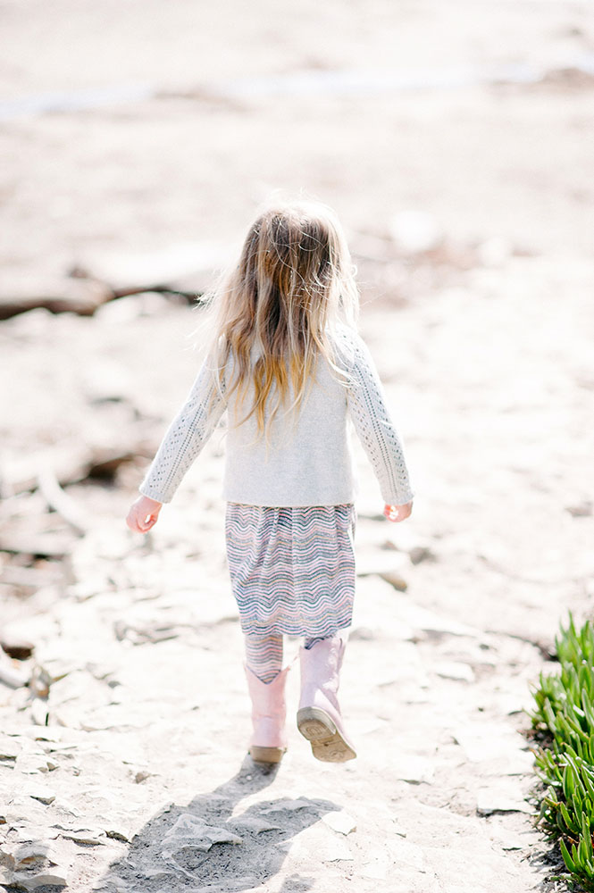little girl with pink boots and long blond hair