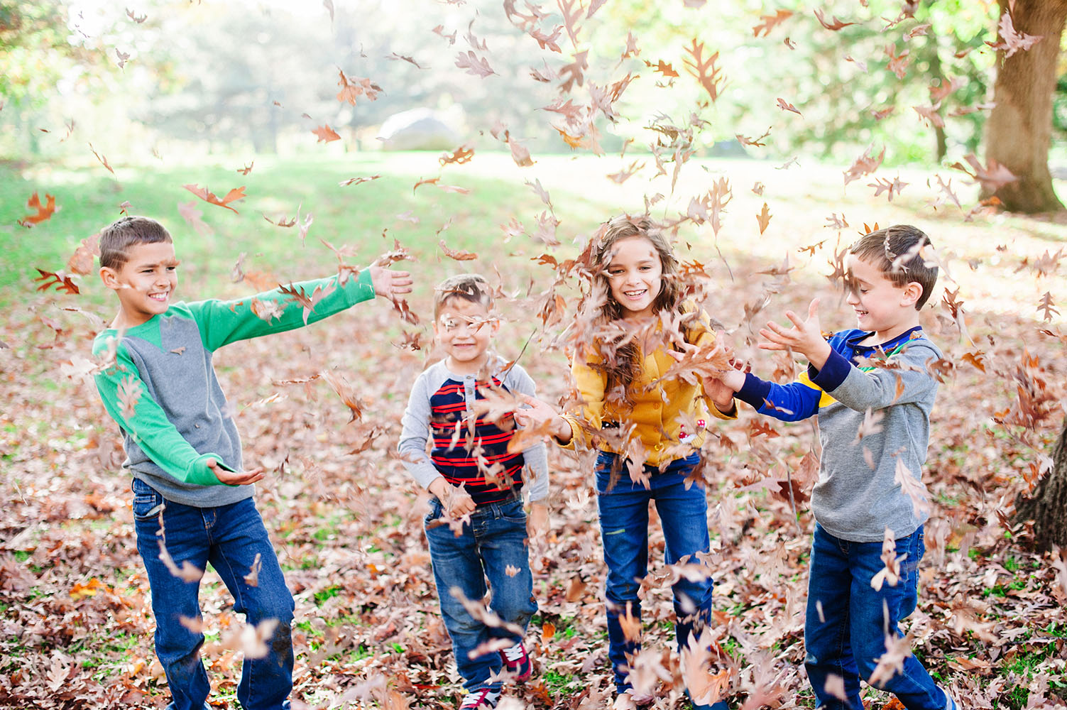 Kids playing in the leaves