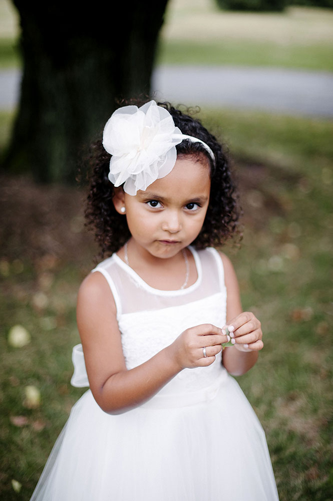 flower girl with white flower headband