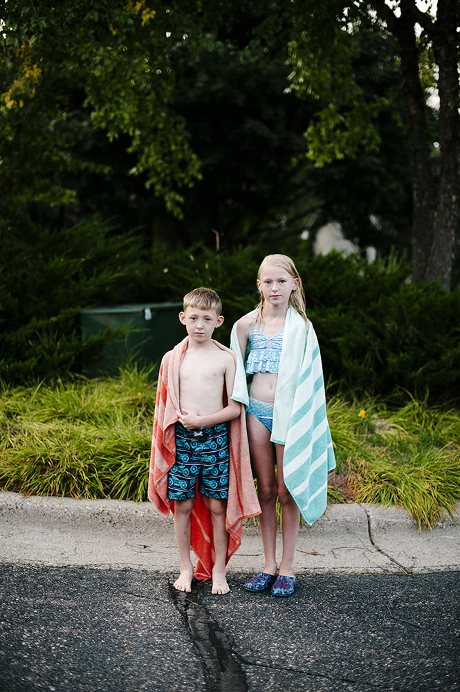 two kids in swimsuits