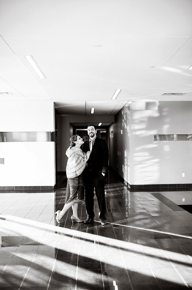 Black and white image of bride and groom in hotel lobby