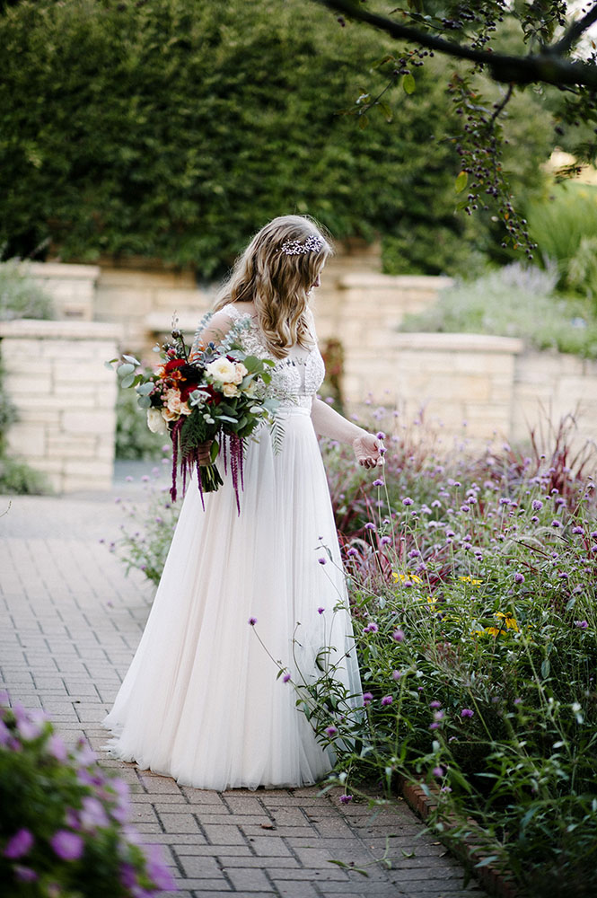 bride at The Minnesota Landscape Arboretum with bouquet