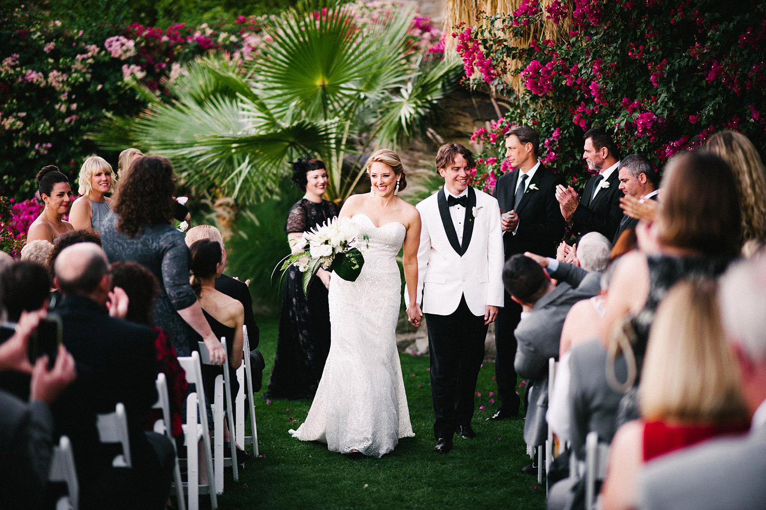 Married couple walking down the aisle in Palm Springs California