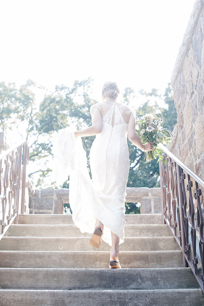bride running up stairs