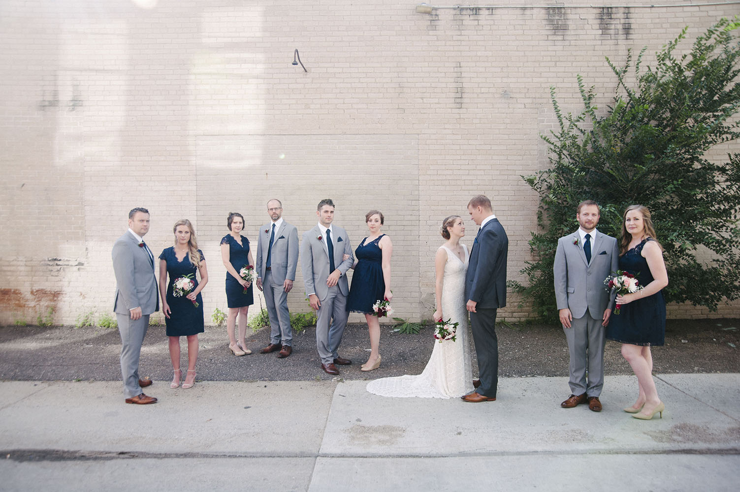 bridal party in dark blue in urban setting