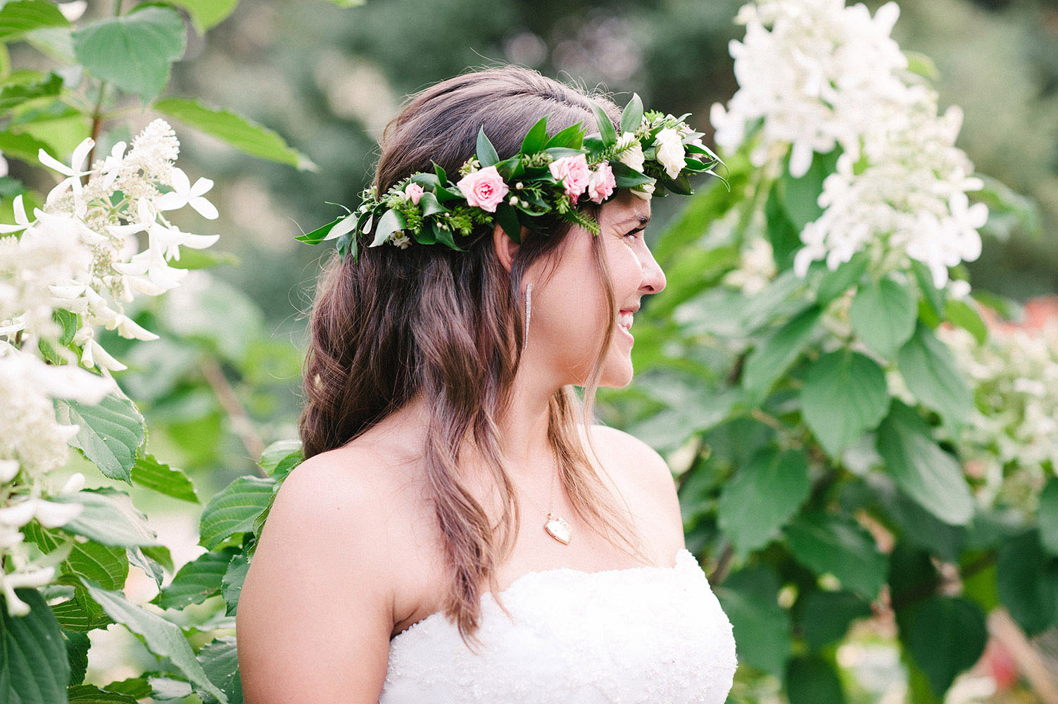 Bride with long brown hair and pink and green floral crown