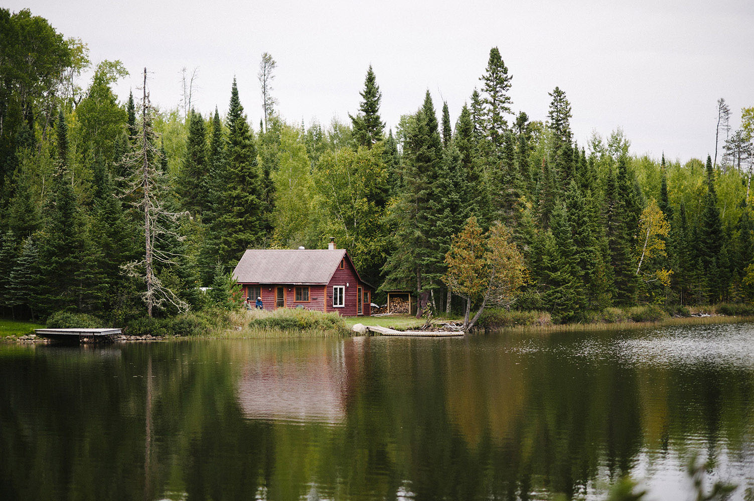 dark red cabin on a lake near the North Shore of Minnesota