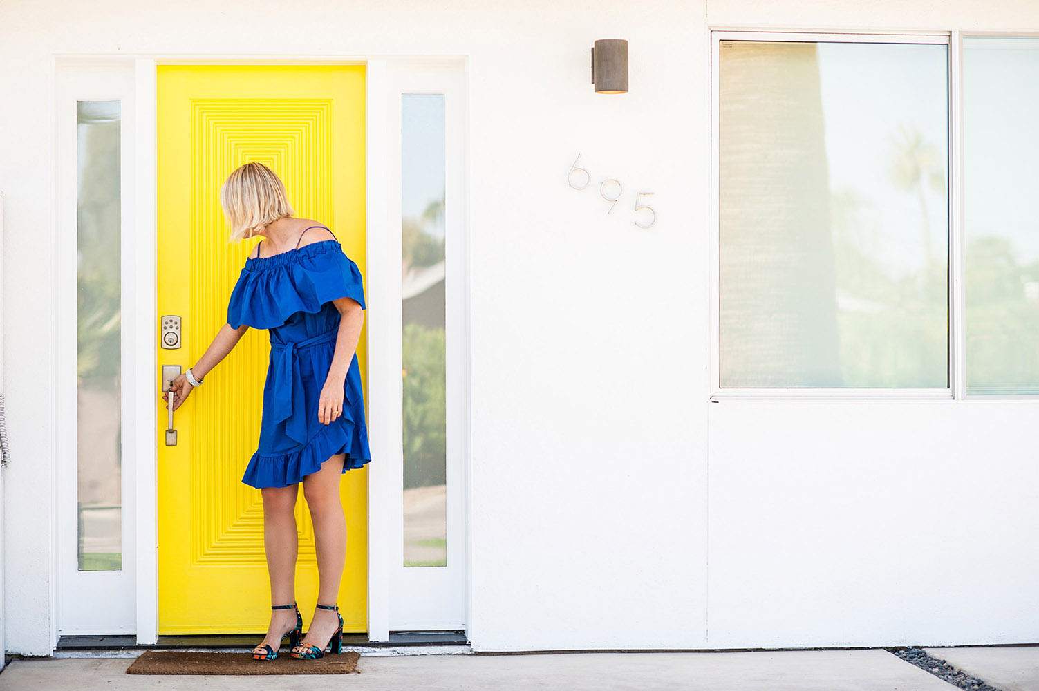 Girl in Blue dress with yellow door