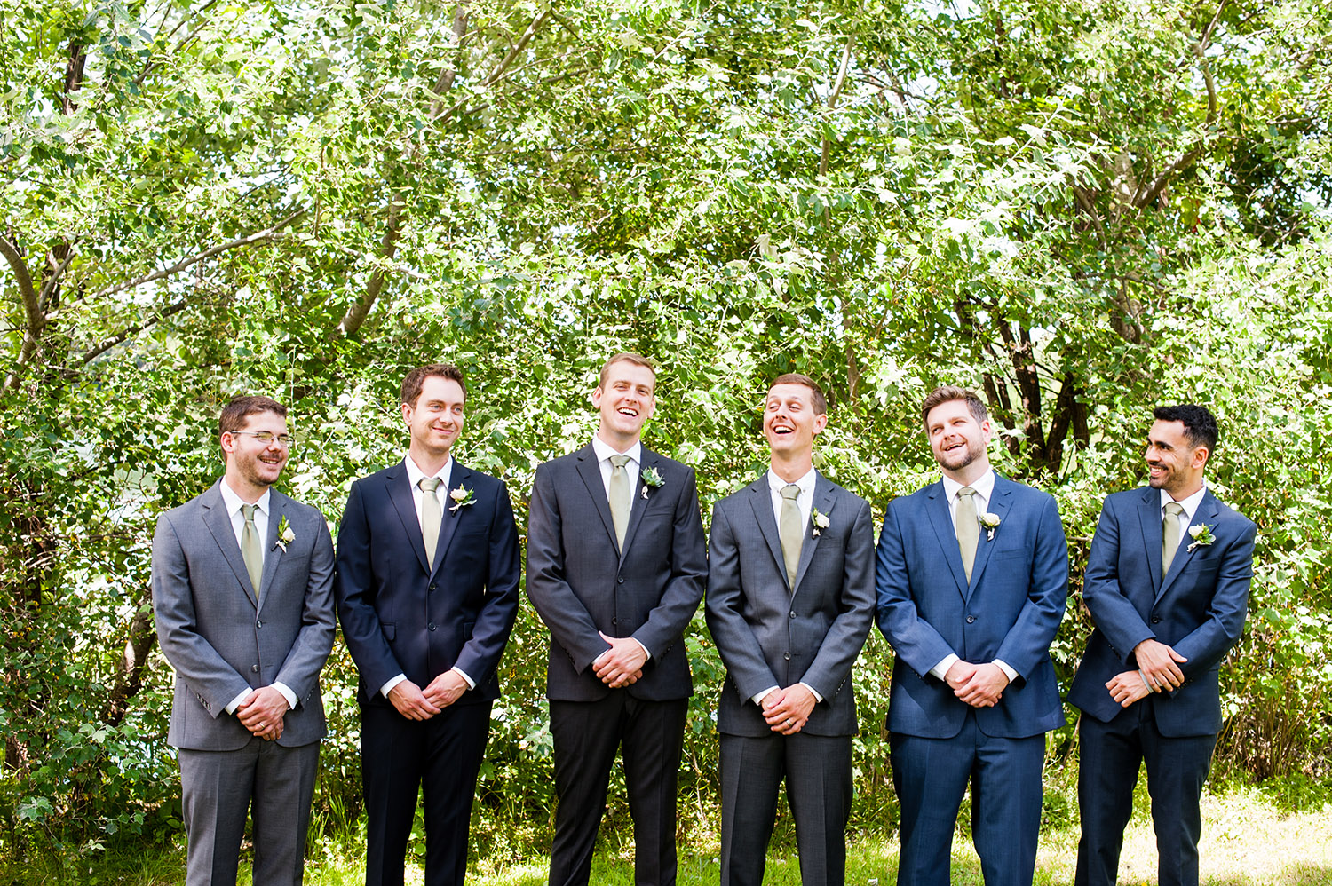 groom with groomsmen laughing