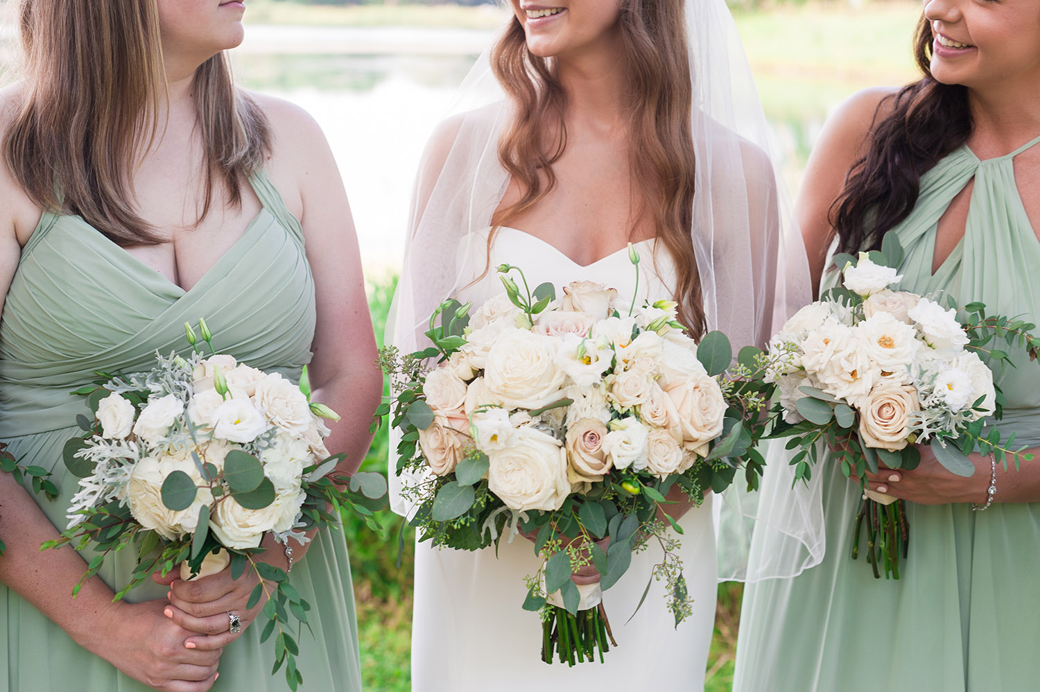 bride with bridesmaids in pale green dresses