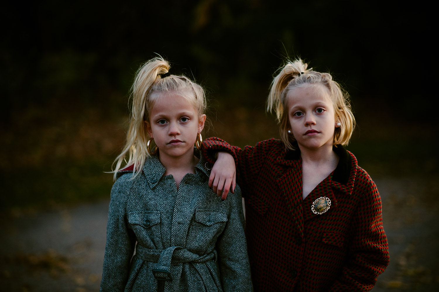 twin girls in vintage winter coats
